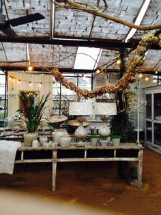 Lamps and dried flower garland- Petersham Nurseries