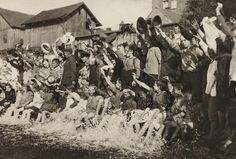 Children celebrate in the Nogat River, Poland.