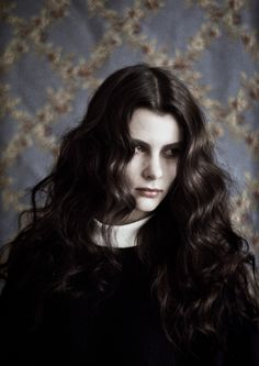 Character inspiration: woman with black hair, pale skin,
