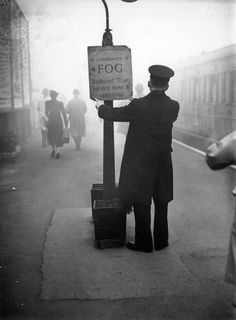 Inch Print (other products available) - October A rail worker fixing a fog warning notice at South Woodford Railway Station in Essex. (Photo by H. Davis/Topical Press Agency/Getty Images) - Image supplied by Fine Art Storehouse - print made in the UK Vintage London, Old London, Vintage Photographs, Vintage Photos, Photomontage, Essex England, London England, London History, Oscar Wilde
