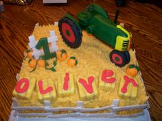 Oliver's Tractor Birthday Cake - All props...including tractor were made from fondant...cake covered in buttercreme frosting!!!