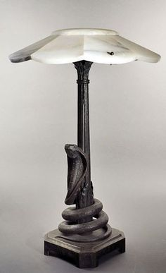 An Art Deco patinated iron and alabaster lamp by Charles Piguet, France circa 1925.