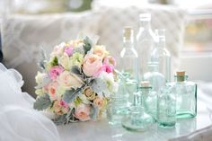The variety of blue turquoise bottles from Vintage Origami. Florals Classic Creations. Photo by Janelle Photography. Design, stylization and props by Vintage Origami.