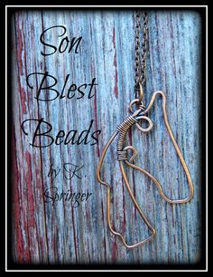 Equine wire horse head pendant / necklace. Created from oxidized copper wire. By artist, Kimi Springer of Son Blest Beads http://www.ebay.com/sch/sonblestbeads/m.html?item=281167463243&pt=Handcrafted_Artisan_Jewelry&hash=item4176e3034b&rt=nc&_trksid=p2047675.l2562