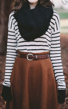 Black knit infinity scarf, black and white striped shirt, and brown midi skirt.