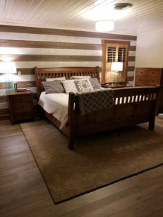 Bedroom remodel using ClassicPine Cottage White on the ceiling and Easy BarnWood in Traditional White and Old Barn Gray on the wall by Great American Spaces