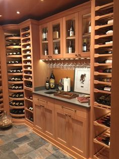 This Santa Fe custom #winecellar is crafted in Fijian Mahogany and features Revel's rotating wine wheel towers, sliding pullouts and upper storage cabinets with glass rack storage molding.
