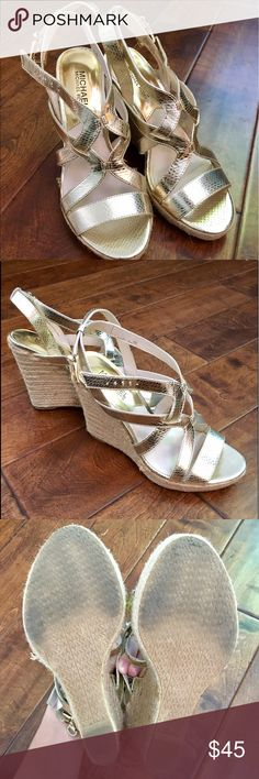 Michael KORS Gold Wedges Great condition. Gently used. Slightly scratch on the front of one as shown that exposes leather underneath. Scratch could likely be repaired with a gold pain pen from Michaels. Adorable summer shoes! MICHAEL Michael Kors Shoes Espadrilles