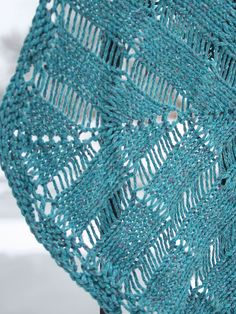 Windlass combines dropped stitches and easy elongated stitches in a top-down triangular shawl.