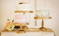 Beautiful wedding cake on three gold cake stands. Cake by Stacy Brooks.
