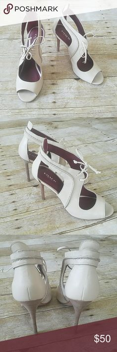 """Coach Cream leather heels So adorable! In great condition. Slight wear on bottoms. Horse shoe open in front with lace the. Heels are 4 1/2"""" Coach Shoes Heels"""