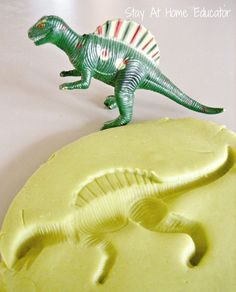 Dinosaur fossils in play dough - Stay At Home Educator