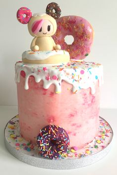 A Tokidoki Donutella themed birthday cake, with real donuts and swiss meringue buttercream <3  www.omm-nom.com
