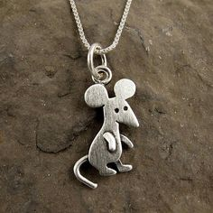 This funny little mouse is made of sterling silver with a soft brushed finish. He measures about 1/2 tall, which means that this a TINY mouse, but thats a big part of what makes him so cute. You can purchase just the pendant/charm, or complete the necklace with a sterling silver box