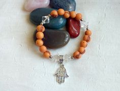 Brazilian Acai Seeds, Czech Glass beads and Hamsa Hand Charm stretchy Protection Bracelet via LauraBijoux. Click on the image to see more!