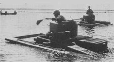 T-37A amphibious tanks traveling across a river, 1930s