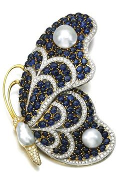 Cultured pearl, sapphire and diamond brooch Designed as a butterfly, set with baroque mabé cultured pearls, cabochon sapphires and brilliant-cut diamonds. #DiamondBrooch