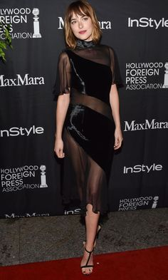 Dakota Johnson opted for an uncharacteristically risque dress at the HFPA/InStyle Annual TIFF Celebration Toronto International Film Festival; showing off her toned figure a velvet and sheer panel piece from Christopher Kane's AW15 collection.