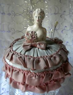 Vintage pin cushion with porcelain half doll.