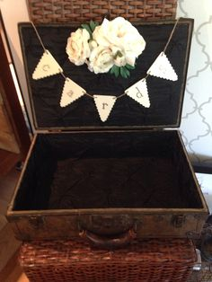 Vintage brown leather suitcase with black, quilted silk lining for cards. Love the flower detail!