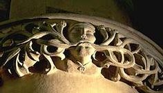 A Green Man wearing a sunwheel on a chain around his neck  Much Marcle in Herefordshire UK  [From author Mike Harding's site]