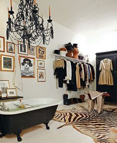love the tub with chandelier in closet. Love the dress on the door