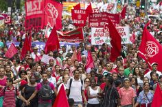 Crowds march against 'coup' targeting Brazil's president #RagnarokConnection