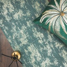 The Milan Metallic Wallpaper in Emerald pairs perfectly with dark oak flooring and gold accessories for a sophisticated looking room.