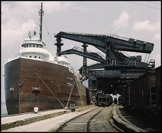 """Pennsylvania R.R. (railroad) ore docks, unloading ore from a lake freighter by means of """"Hewlett"""" [i.e. """"Hulett""""] unloaders, Cleveland, Ohio - Dark Roasted Blend"""