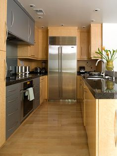 Smooth, Efficient Galley kitchen makeover - interesting, refrigerator at the other end.