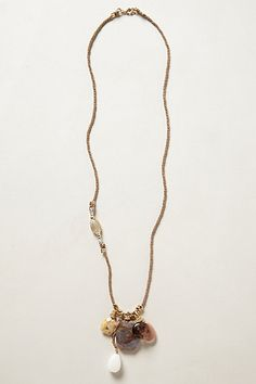 Maidstone Necklace #anthropologie  My favorite part about this necklace is the spot on the left where the chord stops and turns into beads, then continues to be a chord again