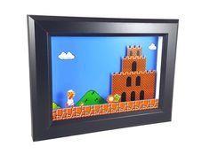 We always thought that throwing fire balls is Mario's coolest power. Show your love for the little plumber with this Super Mario Bros Shadowbox/