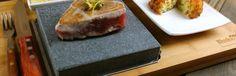 Ahi Tuna Steak on black rock grill hot cooking stone