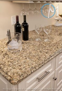This is the granite I want and am re-facing to new white cabinets like this.  I need to add the hanging wine thingy.