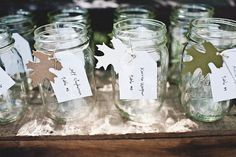 jars used for the guests drink. Little place card tied around the top. Cute and rustic.