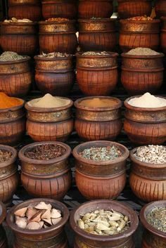 Beautifully carved handmade pots full of aromatic spices