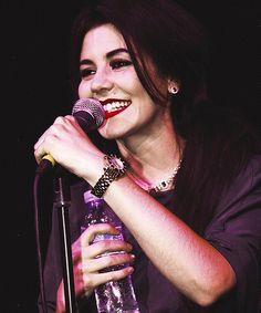 Marina smiling on stage