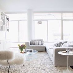 I ADORE floor-to-ceiling windows in an upper level apartment like this!!