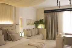 soft neutral bedroom suite - fabulous lighting behind headboard - Borgo Egnazia, Puglia