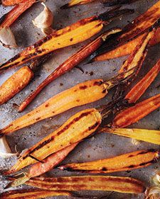 Roasted Carrots with Garlic Recipe via Whole LIving.  Photo credit John Kernick.