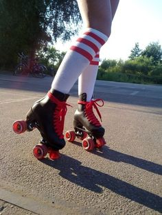 rollerskates with red wheels, red laces and white 'n red stockings