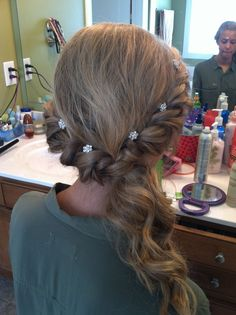 simple but elegant prom twist and pulled to the side w/ curls hairstyle for prom loos like bells hair :)