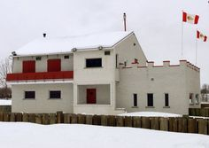 The former Hells Angels stronghold in a town halfway between Montreal and Quebec City is being demolished. The flags of the Hells Angels biker gang fly over their fortified bunker in Trois Rivieres, Que., Wednesday March 28, 2001. THE CANADIAN PRESS/Ryan Remiorz