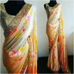 4b8fb76086ac44 Beautiful satin multi color designer saree with sequence boarder. Designer  saree with stunning sleeveless gold designer blouse.