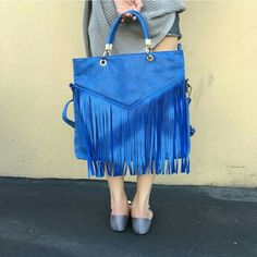 """Infie style Blue Celibrity  big fringed handbag Infie style Blue Celibrity  big fringed handbag   Exterior - 15"""" W bottom X 13"""" H X 2.6"""" D, handle-8"""" drop, Shoulder Strap - 28"""" drop   Indie inspired. Long ruffles. One external zipper pocket on the backside. Two internal zippered pockets. One internal accessible small pouch. High quality synthetic pu leather material Bags Totes"""