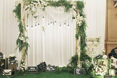 Rustic wooden arch with greenery and hanging bulbs reception stage decor, ceremony backdrop, wedding