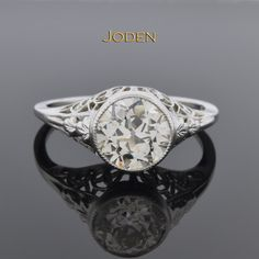 Art Deco Filigree Diamond Engagement Ring. Remarkable filigree compliment the 1.63 carat old European cut diamond in this lovely engagement ring. The diamond is bezel set with a miligrain detailed edge.