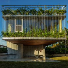 Completed in 2015 in Miami Beach, United States. Images by Todd Eberle , Casey Kelbaugh . Studio Christian Wassmann and restaurateur Frank Prisinzano are pleased to announce the opening of the Sun Path House in Miami Beach, Florida. Miami Beach, Miami Florida, Facade Design, Exterior Design, Sun Path, Concrete Siding, Solarium, Bungalow Extensions, Green Facade