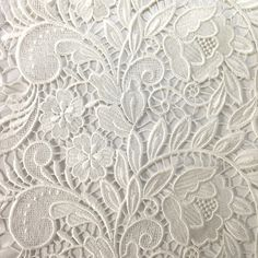 The tulip inspired design of our Guipure French Venice Lace is 52/53'' inches wide and 100% polyester. This fabric is available in several colors and sold by the yard. This wonderful lace is perfect f