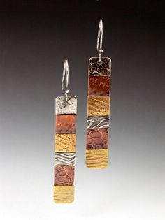 This listing is for the long earings only. All other items are sold separately. Sterling silver, brass and copper are cut and textured with